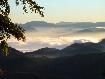 Dimineata in Piatra Craiului cu vedere spre muntii Postavaru si Piatra Mare
