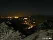 Zarnesti city at night seen from Piatra Craiului Mountains