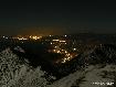Orasul Zarnesti noaptea vazut din Piatra Craiului iarna